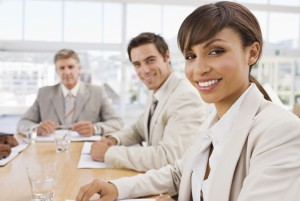 Portrait of business colleagues sitting together at meeting
